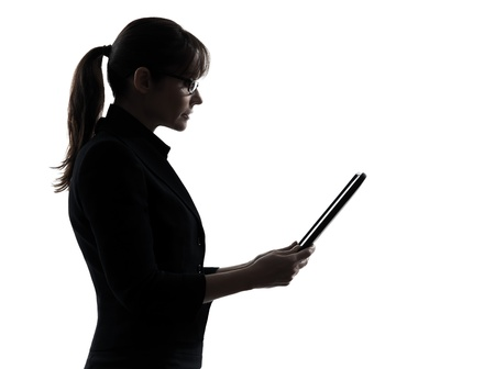one business woman computer computing digital tablet  silhouette studio isolated on white background photo