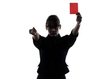 one business woman show a red card silhouette