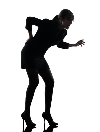 business woman backache pain  silhouette studio isolated on white background photo