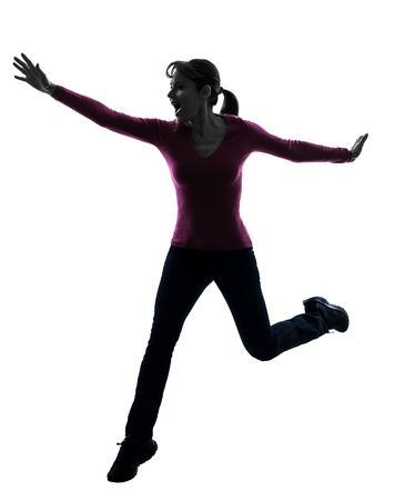 woman screaming: one caucasian woman happy running jumping   in silhouette studio isolated on white background