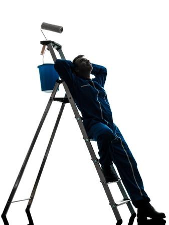 pintor de casas: un hombre cauc?sico casa pintor trabajador silueta en estudio en el fondo blanco Foto de archivo