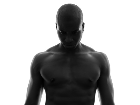 afro american nude: one african  black man topless looking down sad  in silhouette studio on white background