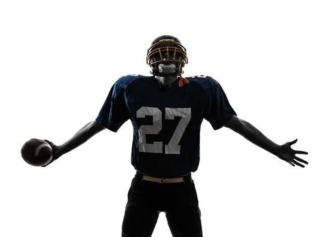 the football player: un jugador de f?tbol americano cauc?sico hombre triunfante en el estudio de la silueta aislado en el fondo blanco