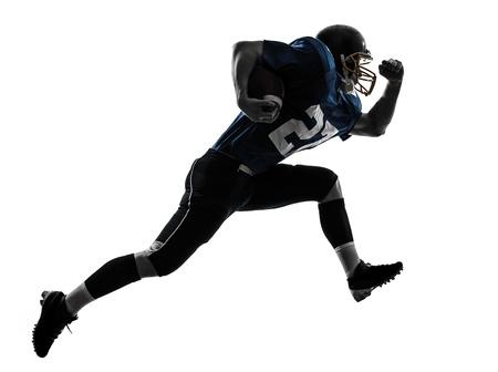 jugador de futbol: un hombre cauc?sico de f?tbol americano jugador que corre en el estudio de la silueta aislado en el fondo blanco