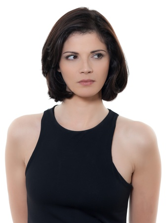 mistrust: one beautiful suspicious caucasian woman portrait in studio isolated on white background