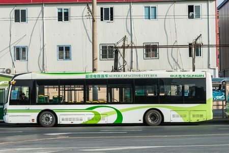 Shanghai, China - April 7, 2013  electric powered hybrid bus charging at the city of Shanghai in China. 에디토리얼