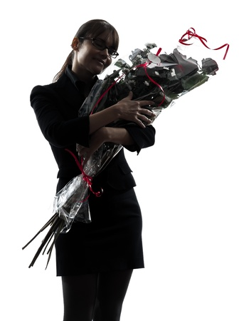 one business woman hugg g flowers bouquet  silhouette studio isolated on white background photo
