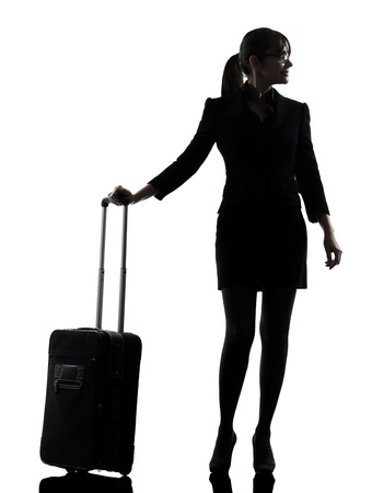 one business woman traveling standing  silhouette studio isolated on white background photo