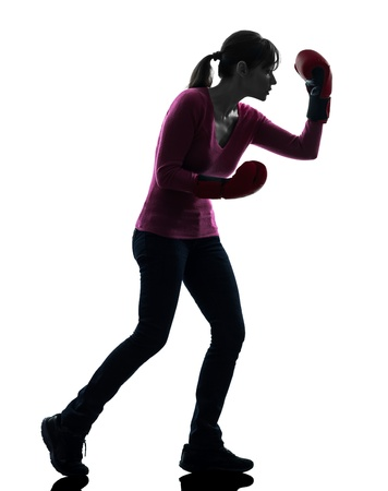 one caucasian woman with boxing gloves  in silhouette studio isolated on white background photo
