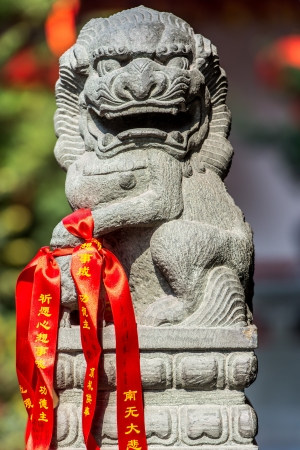 jade buddha temple: chinese imperial lion statue in the The Jade Buddha Temple shanghai china