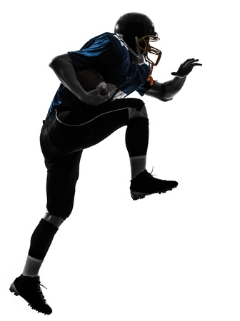 american football background: one caucasian american football player man running   in silhouette studio isolated on white background Stock Photo