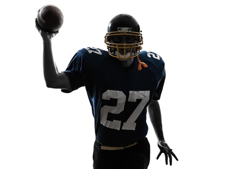 one caucasian quarterback american throwing football player man in silhouette studio isolated on white background Stock Photo - 19754871