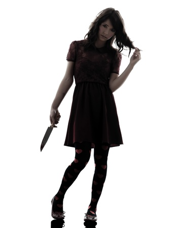 one caucasian strange young woman holding  bloody knife in silhouette white background