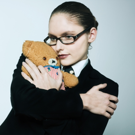 studio shot portrait of one caucasian young woman  holding a teddy bear photo