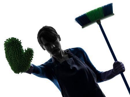 brooming: one caucasian woman maid cleaning brooming  stop gesture in silhouette studio isolated on white background Stock Photo