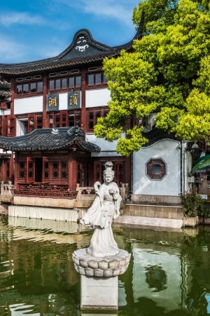 fang: ancient statue on a pond in Fang Bang Zhong Lu old city shanghai china