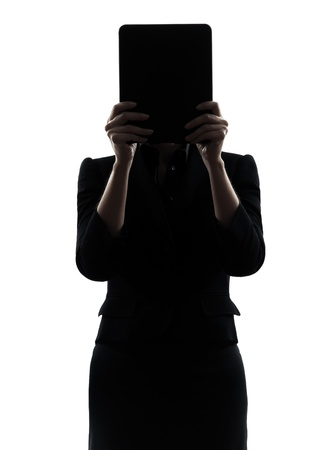 one business woman hid g computer computing digital tablet  silhouette studio isolated on white background photo