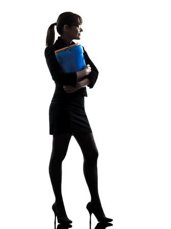 one business woman hold g folders files stand g  silhouette studio isolated on white background photo