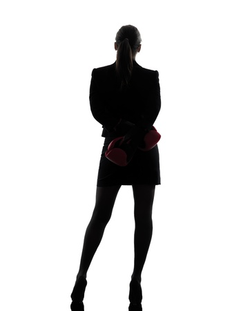 defense: one business woman with box g gloves  silhouette studio isolated on white background Stock Photo