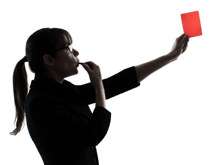 expulsion: one business woman showing red card  silhouette studio isolated on white background