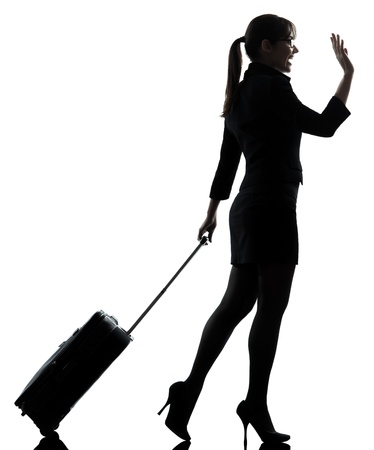 one business woman traveler walking   silhouette studio isolated on white background photo