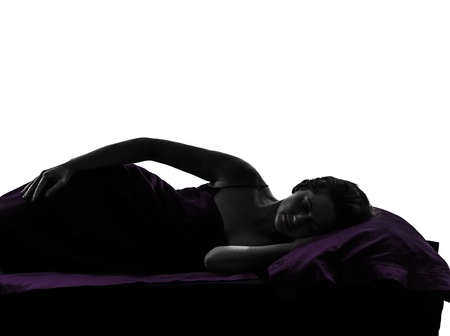 one woman in bed sleeping lying on back silhouette studio on white background photo