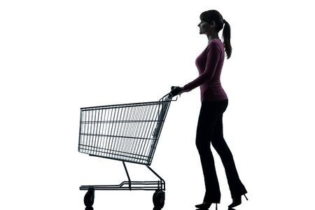 empty shopping cart: one caucasian woman with empty shopping cart in silhouette studio isolated on white background