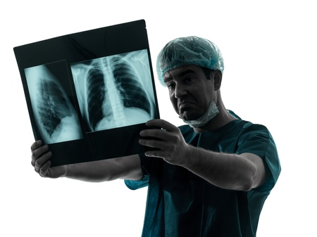 pneumonia: one caucasian man doctor surgeon radiologist medical examaning lung torso  x-ray image silhouette isolated on white background Stock Photo