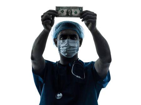 one caucasian man doctor surgeon medical worker  dollar bill  silhouette isolated on white background photo