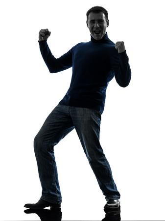 ser humano: un hombre caucásico feliz stong victoriosa de larga duración en estudio de la silueta aislado en el fondo blanco