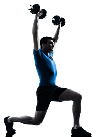 one caucasian man exercising weight training workout fitness in silhouette studio  isolated on white background photo