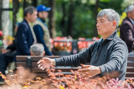 Shanghai, China - April 7, 2013  one man exercising meditation  in fuxing park at the city of Shanghai in China