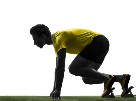 athleticism: one caucasian man young sprinter runner  in starting blocks  silhouette studio  on white background