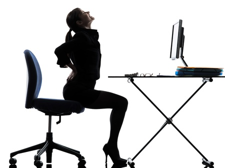 backache: one business woman sitt g backache pa  silhouette studio isolated on white background Stock Photo