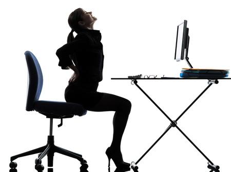 sitt: one business woman sitt g backache pa  silhouette studio isolated on white background Stock Photo