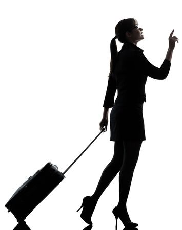 profile view: one business woman traveler walking   silhouette studio isolated on white background