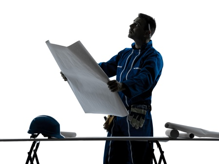 one caucasian man construction  Architect working plans silhouette in studio on white background photo
