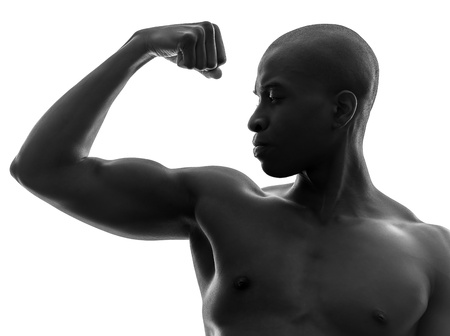 afro american nude: one african  black man flexing muscle  in silhouette studio on white background Stock Photo