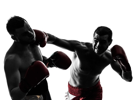 boxing sport: two caucasian  men exercising thai boxing in silhouette studio  on white background