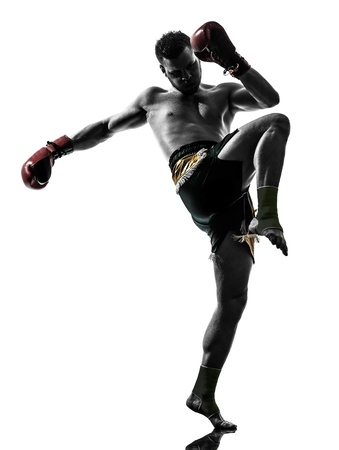 one caucasian man exercising thai boxing in silhouette studio  on white background 版權商用圖片 - 20011648