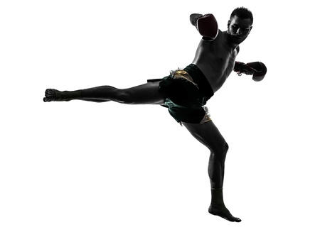 kickboxing: one caucasian man exercising thai boxing in silhouette studio  on white background
