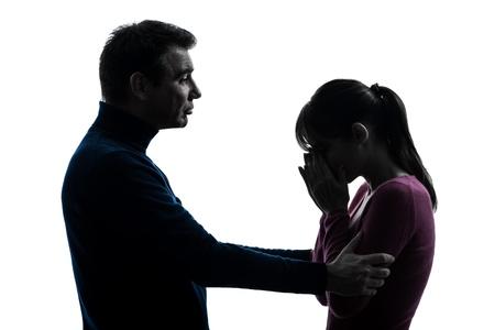 persona deprimida: una mujer llorando cauc?sico consoladora hombre silueta en estudio aislado sobre fondo blanco Foto de archivo