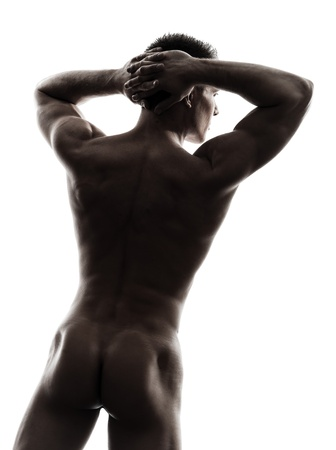 20s naked: one caucasian handsome naked muscular man rear view back in silhouette studio on white background