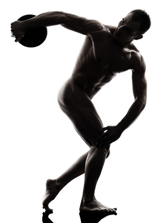 one caucasian handsome naked muscular man exercising discobolus in silhouette studio on white background photo