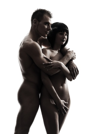 20s naked: one caucasian beautiful young naked couple portrait y  in silhouette studio on white background Stock Photo