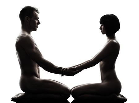 naked young woman: one caucasian couple man woman sexual kamasutra posture love activity  in silhouette studio on white background Stock Photo