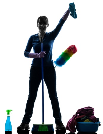 brooming: one caucasian woman maid cleaning products brooming   in silhouette studio isolated on white background