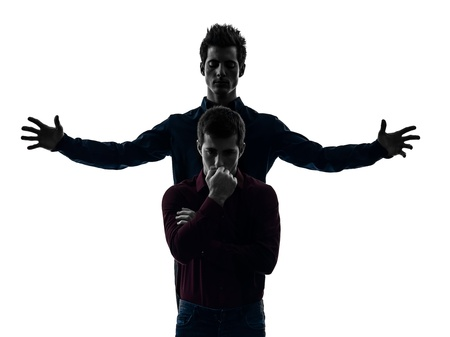 two caucasian young men domination concept shadow  white background photo