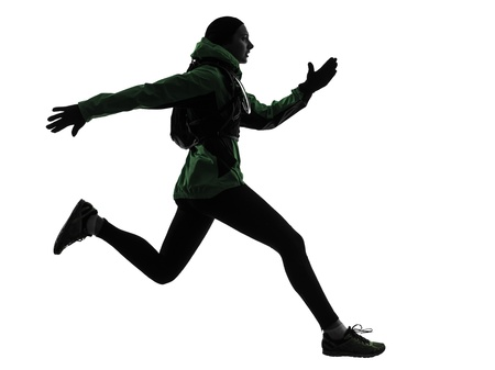 one caucasian woman runner running trekking  in silhouette studio isolated on white background photo