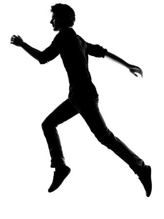 persona: joven corriendo silueta en el estudio aislado sobre fondo blanco Foto de archivo